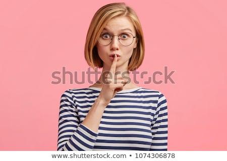 jonge · vrouw · vinger · lippen · vragen · rustig - stockfoto © hsfelix