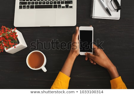 African secretary with coffee cups in hand Stock photo © studioworkstock