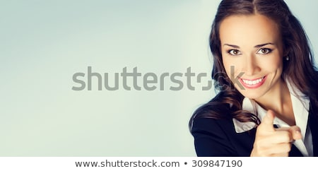 Business woman, pointing forward Stock photo © hsfelix