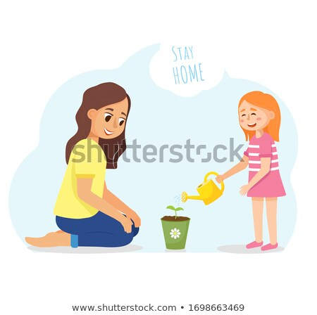 Woman watering pot plant smiling Stock photo © IS2