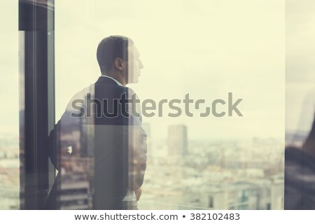 Businessman reflected in glass door Stock photo © IS2