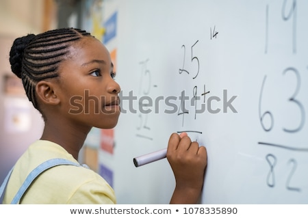 Girl learning to write numbers in primary class Stock photo © monkey_business