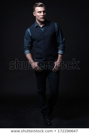 portrait of handsome young man wearing a blue gilet stock photo © feedough