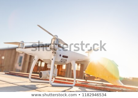 Drone Quadcopter Next to Hard Hat Helmets At Construction Site Stock photo © feverpitch