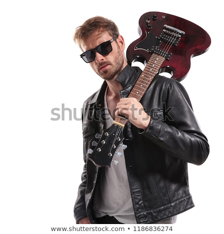 portrait of cool rock star holding his guitar on shoulder Stock photo © feedough
