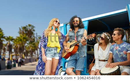 hippie women in minivan car at venice beach in la Stock photo © dolgachov
