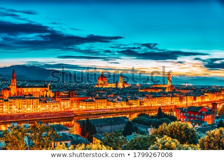Stock photo: Arno river waterfront and illuminated church in Florence evening