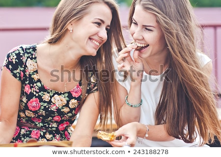 Two pretty happy young girls friends Stock photo © deandrobot