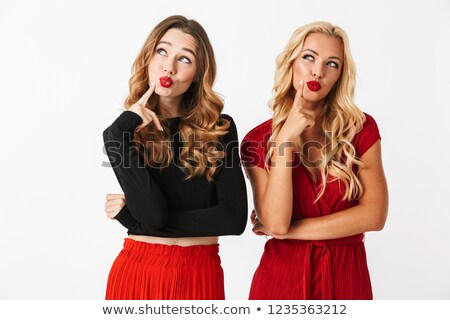 Retrato dois pensativo jovem mulheres Foto stock © deandrobot