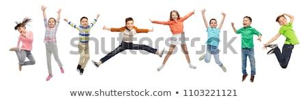 Gelukkige mensen springen lucht witte geluk vrijheid Stockfoto © dolgachov