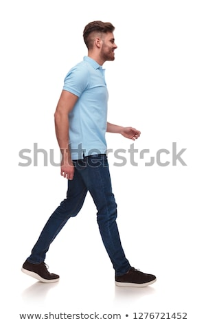 side view of casual man in blue polo shirt walking Stock photo © feedough