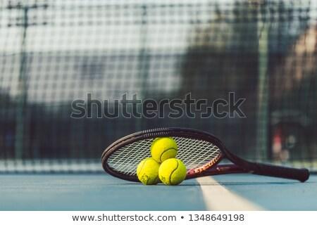 high angle close up of three tennis balls on a professional racket stock photo © kzenon