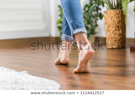 Woman's Feet Walking On Hardwood Floor Stock photo © AndreyPopov