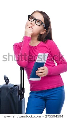 sonriendo · nina · viaje · bolsa · billete · pasaporte - foto stock © dolgachov