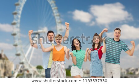 happy friends making fist pump over ferry wheel Stock photo © dolgachov
