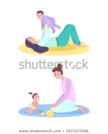 Mother Holding Baby Son, Laying on Mat Isolated Stock fotó © robuart