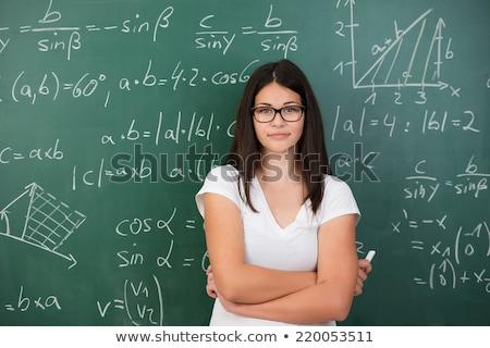 genç · kadın · matematik · öğretmen · kara · tahta · kitap - stok fotoğraf © elnur