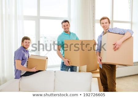 encantado · mulher · caixas · em · movimento · amigo - foto stock © kzenon