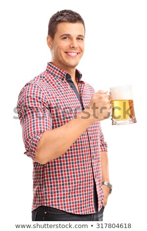 young man holding beer mug smiling stock photo © nyul