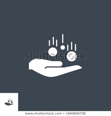 Coin in Hand related vector glyph icon. Stock photo © smoki