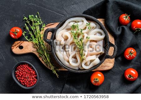Nyers tintahal gyűrűk bors tányér hal Stock fotó © tycoon