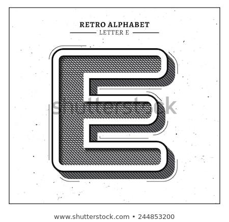 Black engraved font Letter E 3D Stock photo © djmilic