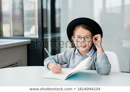 Adorable astucieux écolière chapeau regarder Photo stock © pressmaster