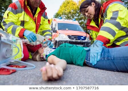 Nood arts gewond vrouw motor ongeval Stockfoto © Kzenon