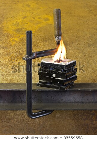 Stock photo: burning hard drives compressed with clamp