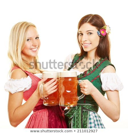 two happy bavarian girls with beer stock photo © Rob_Stark