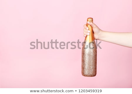 glittering champagne bottle and glass stock photo © glyph