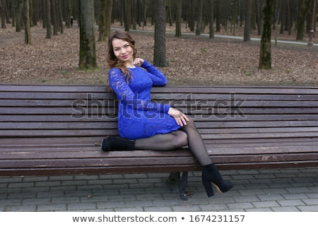 Pretty brown-haired woman sitting on a bench Stock photo © photography33