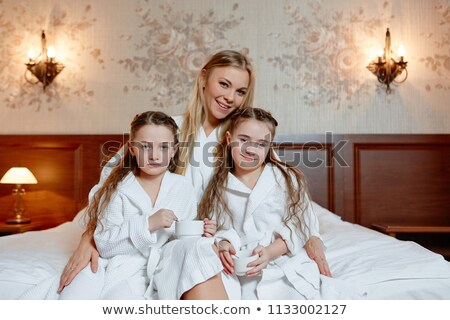 Woman drinking a glass of milk in her bathrobe Stock photo © photography33