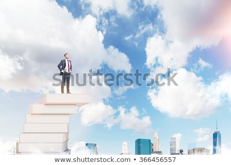 smart businessman in front of blue sky stock photo © photography33