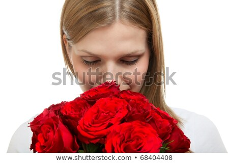 Woman Smelling a Bunch of Red Roses stock photo © feverpitch