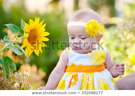 laying girl in yellow dress stock photo © dolgachov