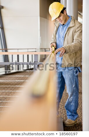 A male construction worker taking measures. Stock photo © photography33