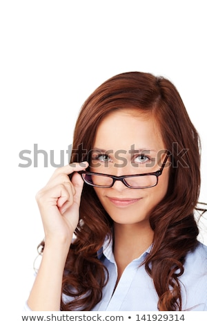 Young woman peering over her glasses Stock photo © photography33