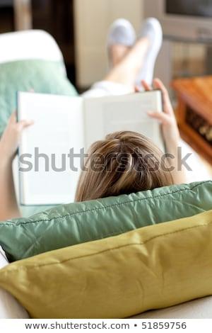 blond · femme · lecture · livre · canapé · portrait - photo stock © wavebreak_media