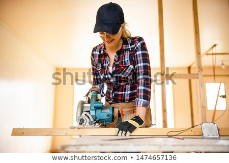 Woman with a circular saw Stock photo © photography33