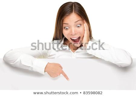 surpreendido · mulher · jovem · olhando · cartão · em · branco · retrato · isolado - foto stock © nobilior