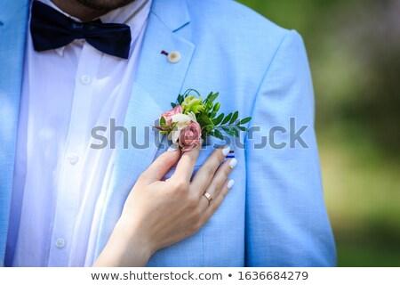 Groom correcting rose in buttonhole Stock photo © luckyraccoon