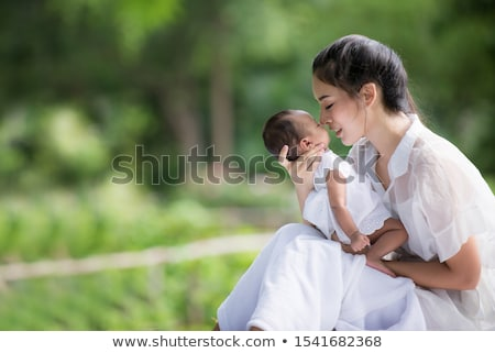 closeup of a baby breastfeeding Stock photo © luckyraccoon