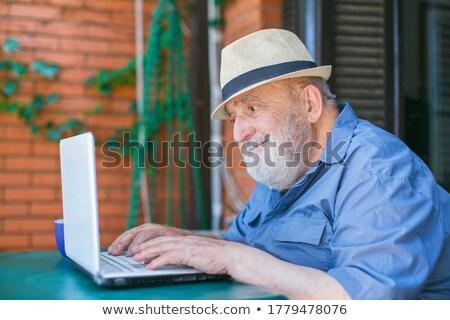 Senior cavalheiro trabalhando laptop ao ar livre computador Foto stock © photography33