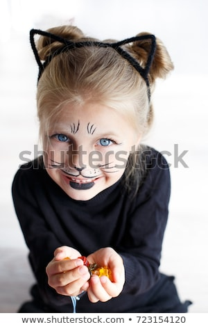 Bonitinho little girl gato make-up pintado cara Foto stock © Mikko