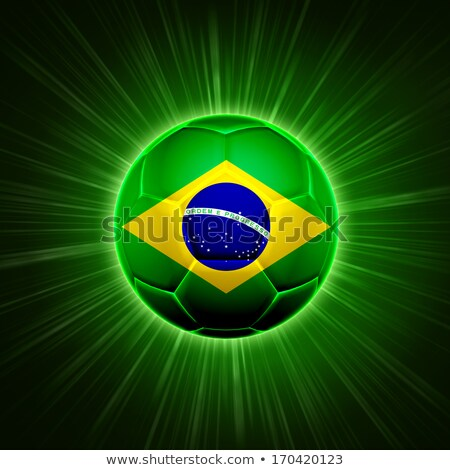 football with brazilian flag over green rays stock photo © marinini