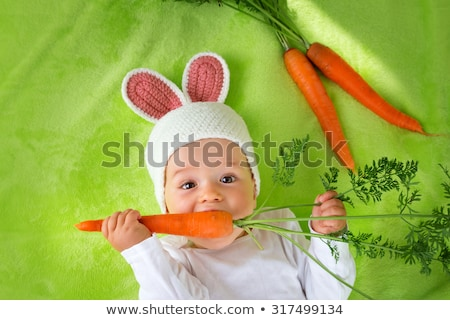 Child as easter hare with carrots Stock photo © ivonnewierink