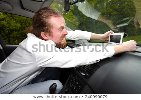 Driver furious on GPS navigation a wrong way Stock photo © vladacanon