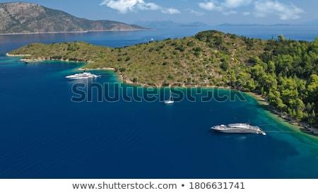íngreme calcário ilha árvores oceano azul Foto stock © smithore
