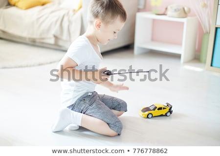 Fiú játszik távirányító fal otthon jókedv Stock fotó © bmonteny